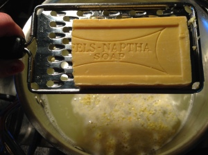 Grate 1/4 of the Fels Naptha Bar into the hot pot of water