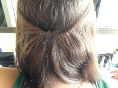 "If your hair is long enough, grab one 1/2""-1"" pieces of front hair from each side. I tied mine in a half knot and then criss crossed the pins in the back. I know they don't match, but I am cool like that."