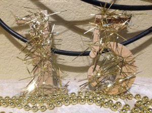 "Using some pieces of gold garland and modge podge, I simply glued some sparkle on my ""15"" NYE decor."
