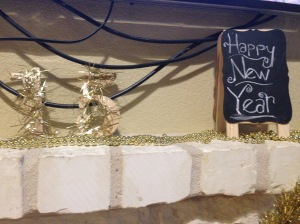 Pardon the wires! I used some gold beads for the top of the mantel, my wooden garland sparkly 15 numbers, and chalkboard gave this part of the house a little shout out. People congregate in the kitchen and dining area, so I left this area simple.