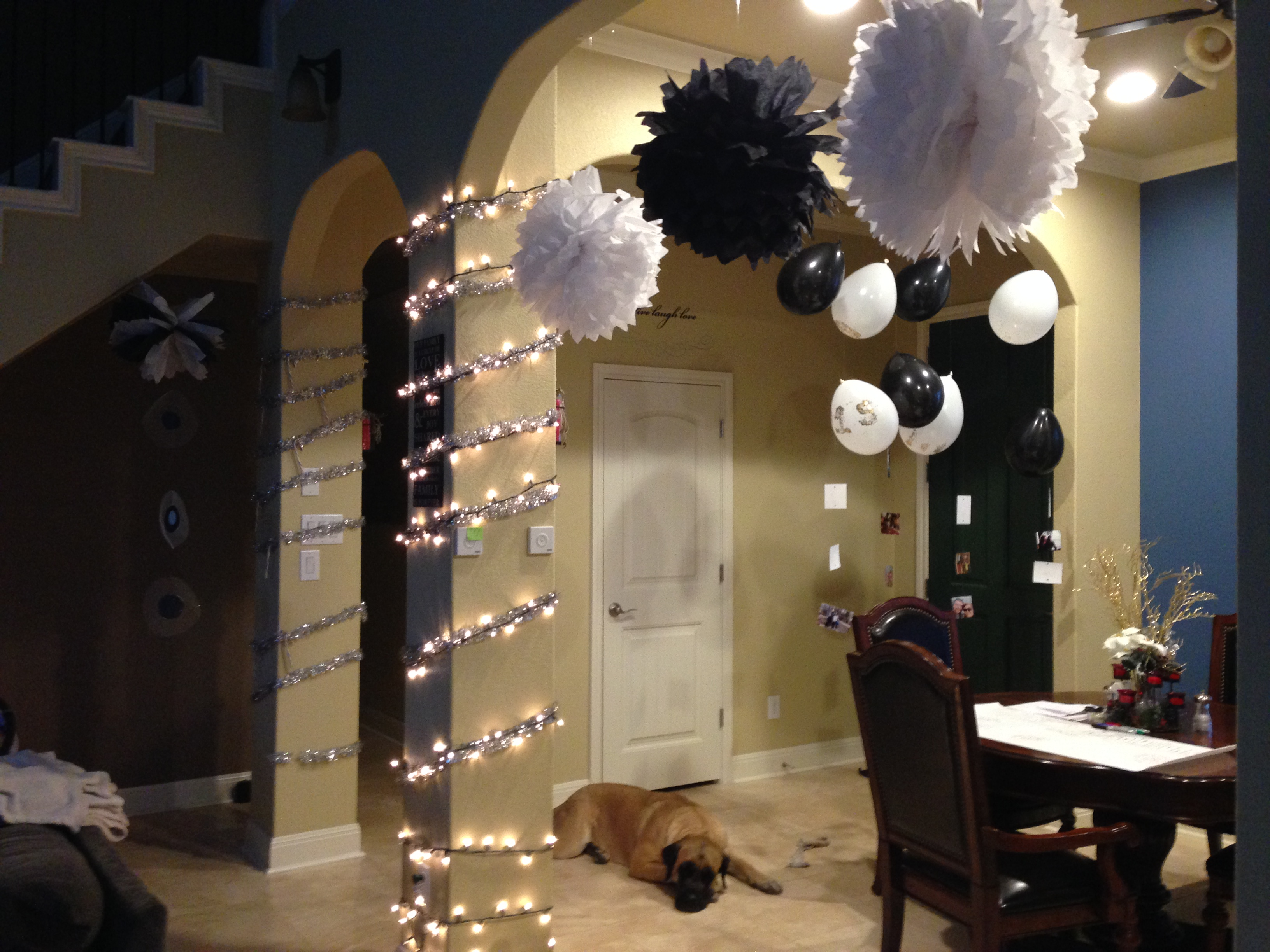 How to diy new years eve party decor on a budget the for Hanging pom poms from ceiling