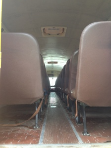Before: Inside of the bus from the rear (28 seats)