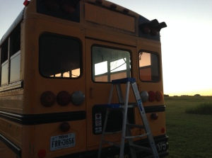 Back of Chitty Bang: After School Bus Sign, Emergency Door Lettering, and reflective tape all removed via heat gun and paint scraper..and a ladder...and a stepstool...